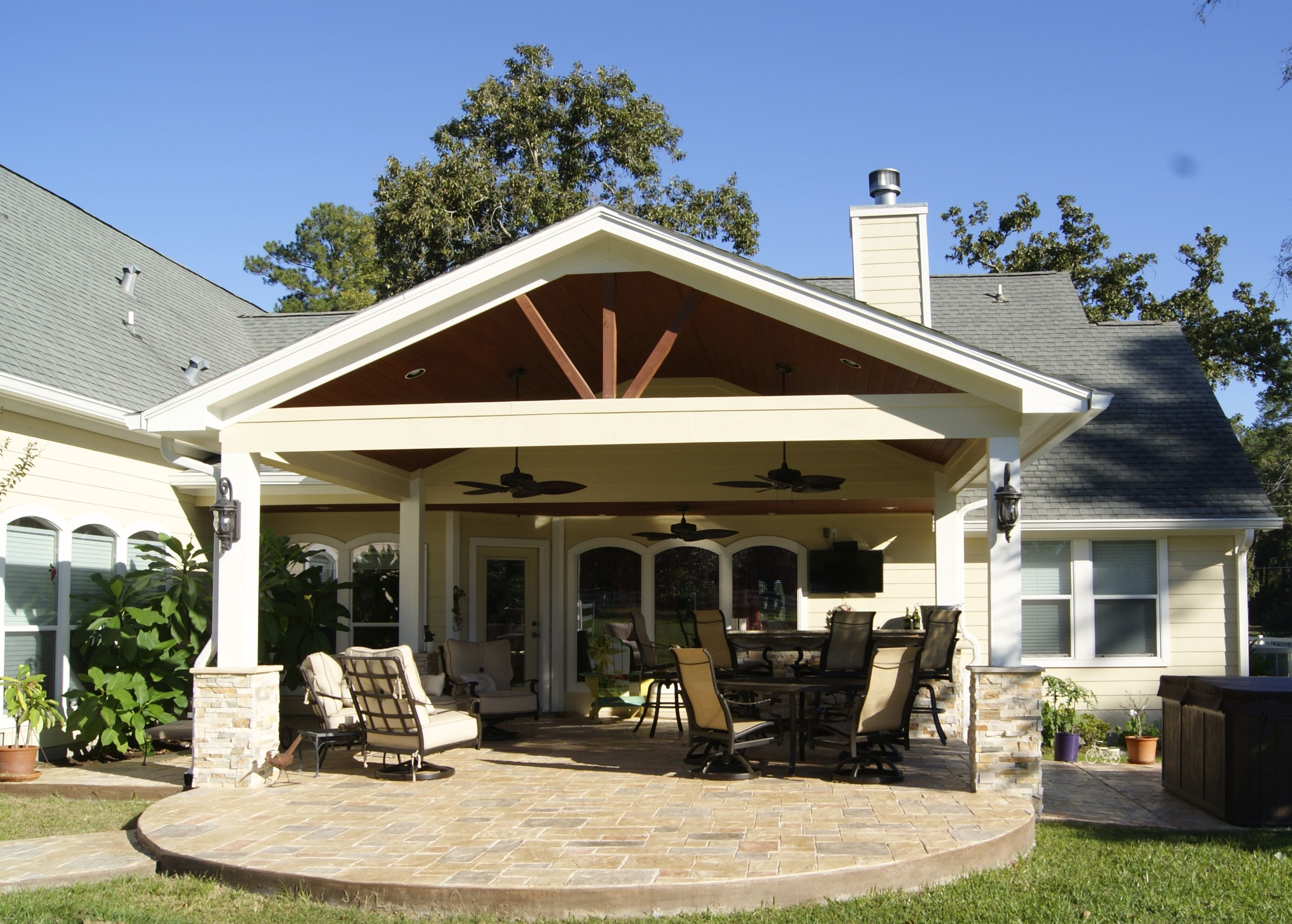 Patio cover with stamped concrete magnolia tx back for Covered back porch designs