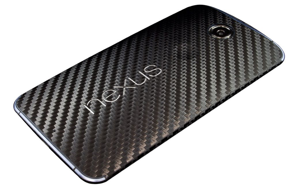Nexus 6 with our most popular black carbon fiber. Our skin covers the sides as well as the top and bottom of the device.   Get it here http://phantomskinz.com/google-nexus-6/