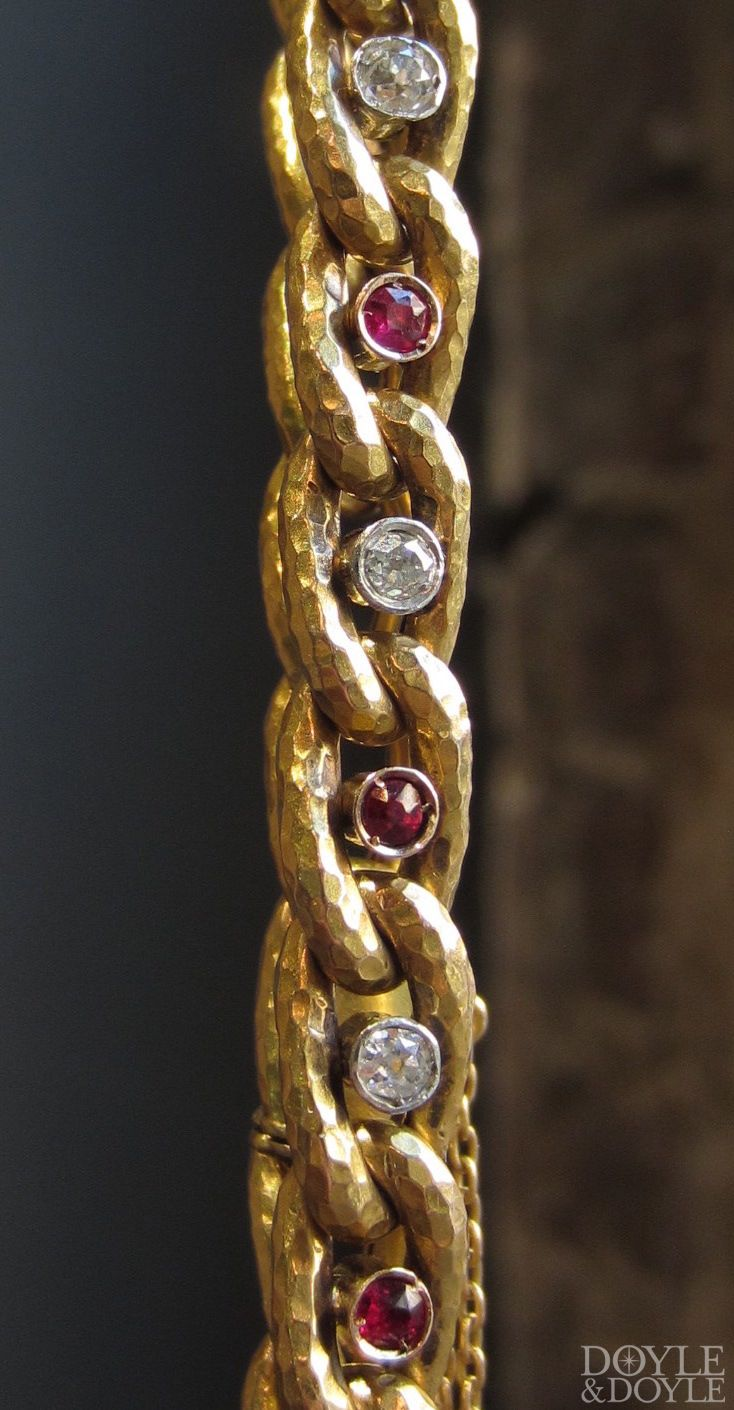 The perfect tailored bracelet to wear every single day. Antique French hammered link bracelet in 18k gold, set with Old European cut diamonds and rubies. Circa 1870, from Doyle & Doyle.