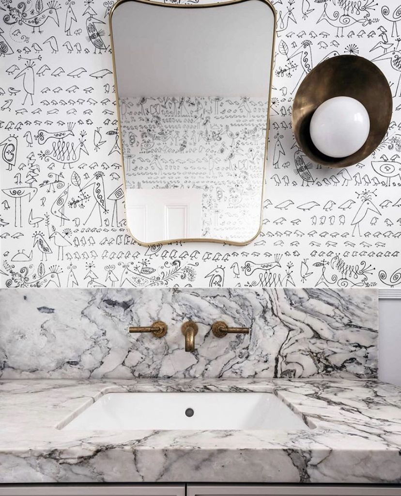 An impeccable powder room project features our Astra