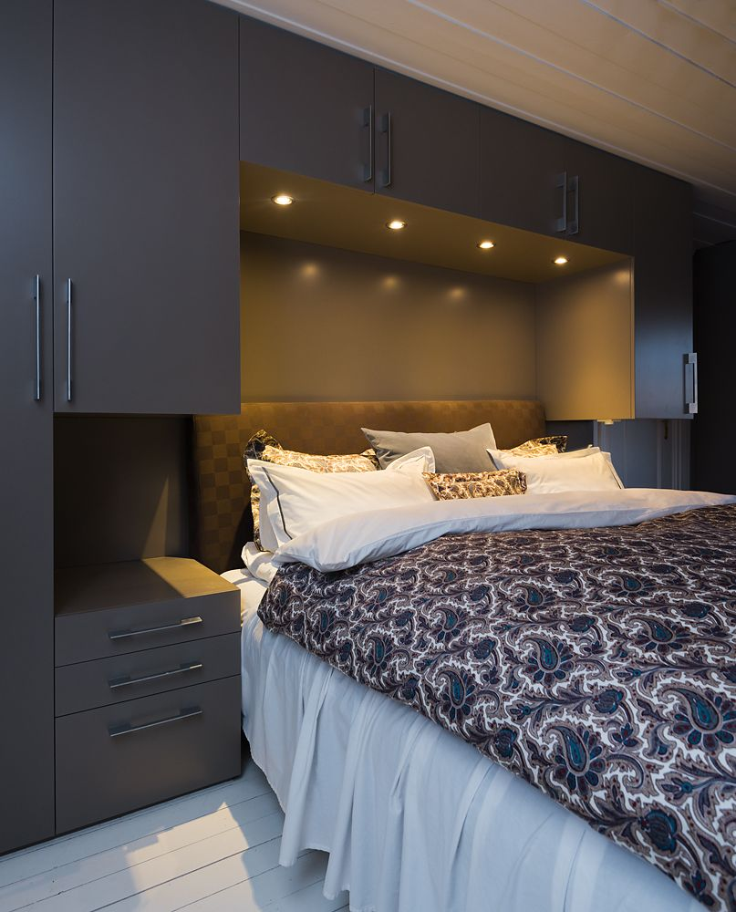 I love that the headboard is doubled as wardrobes and storage! Great way to eliminate the need to find space in a bedroom!