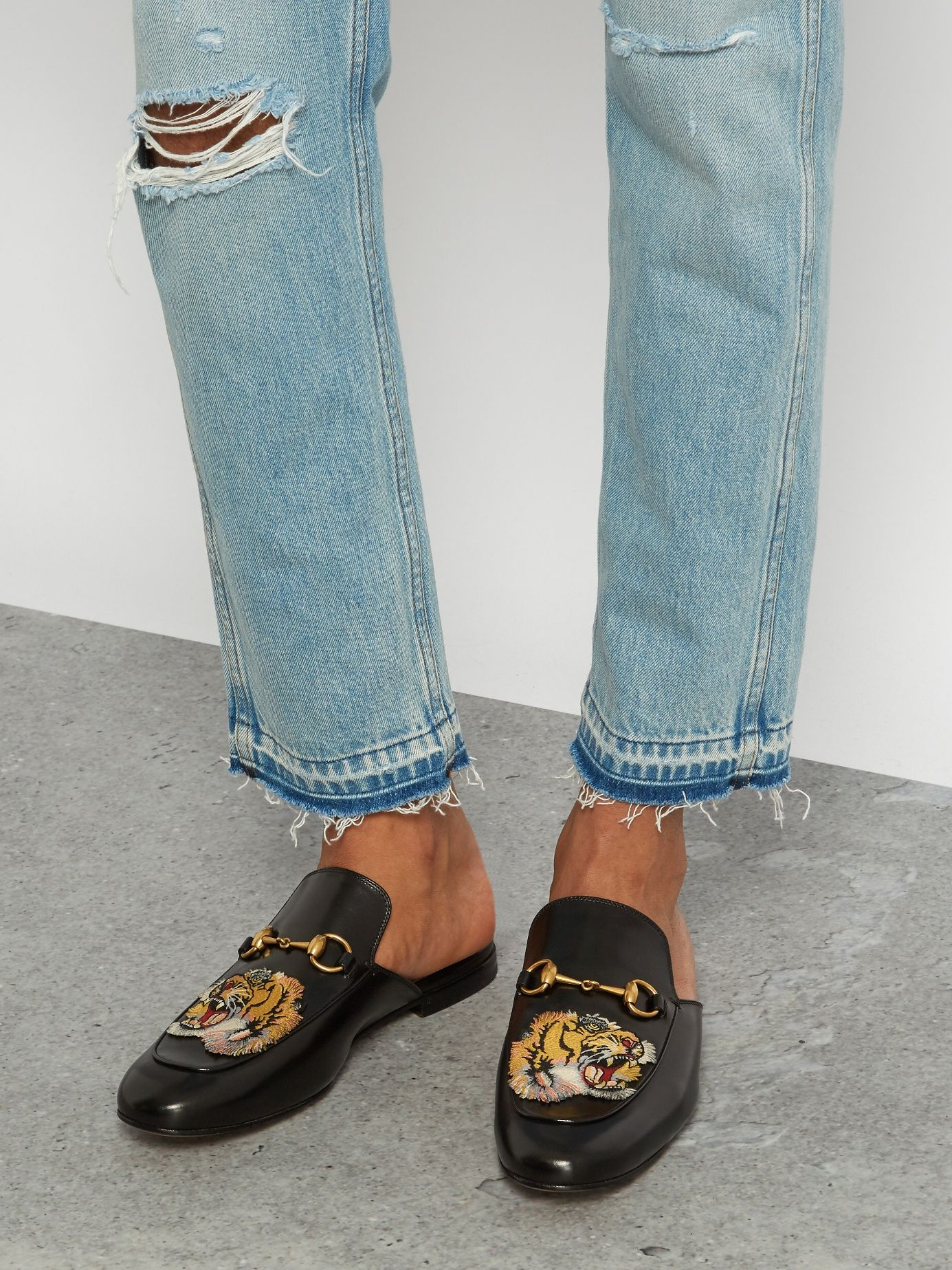 6476763af Click here to buy Gucci Tiger-head embroidered backless loafers at  MATCHESFASHION.COM