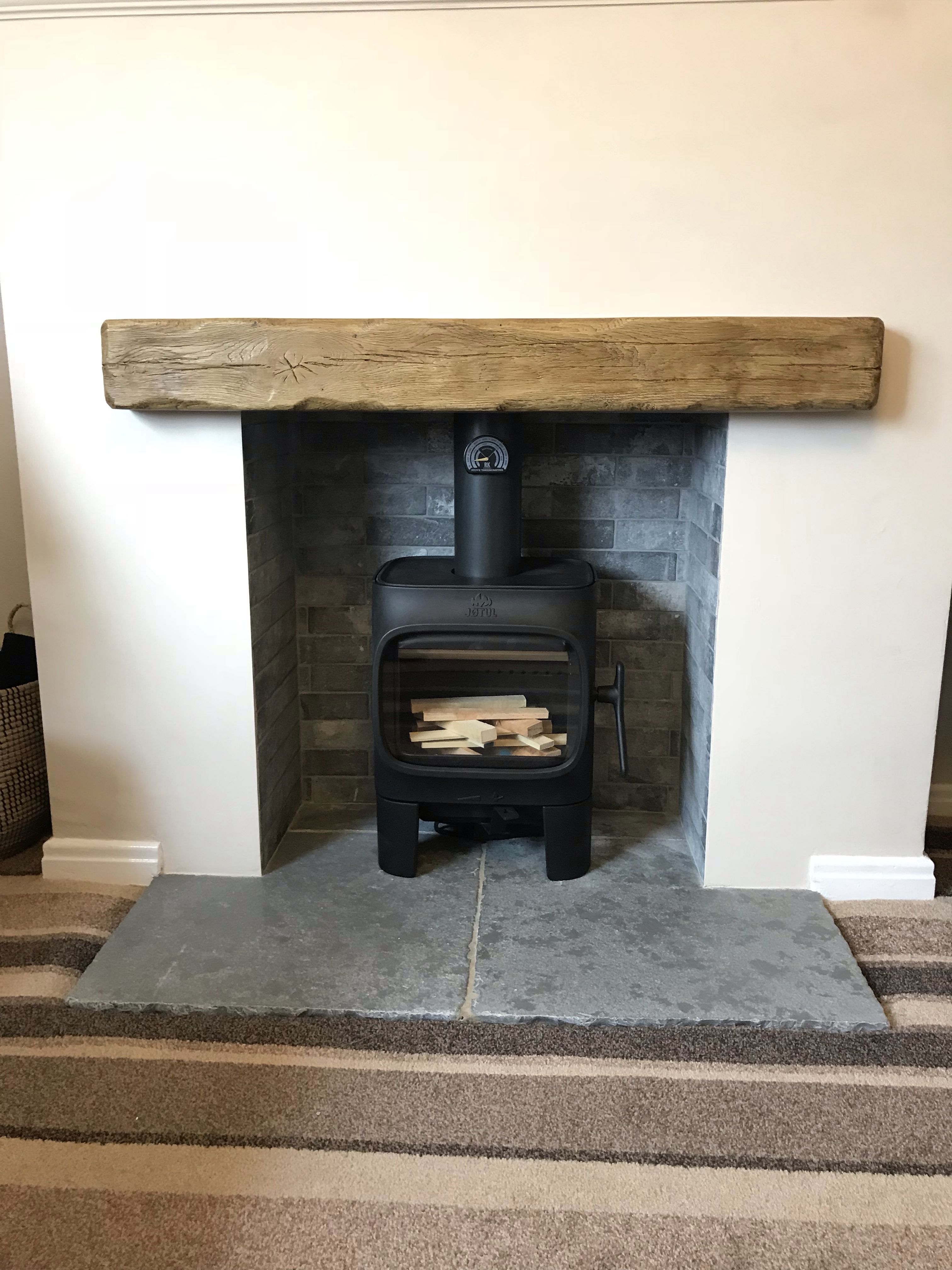 Inserto Camino Jotul C 24 4kw Wood Burning Stove With Grey Brick Effect Tile Chamber Stove