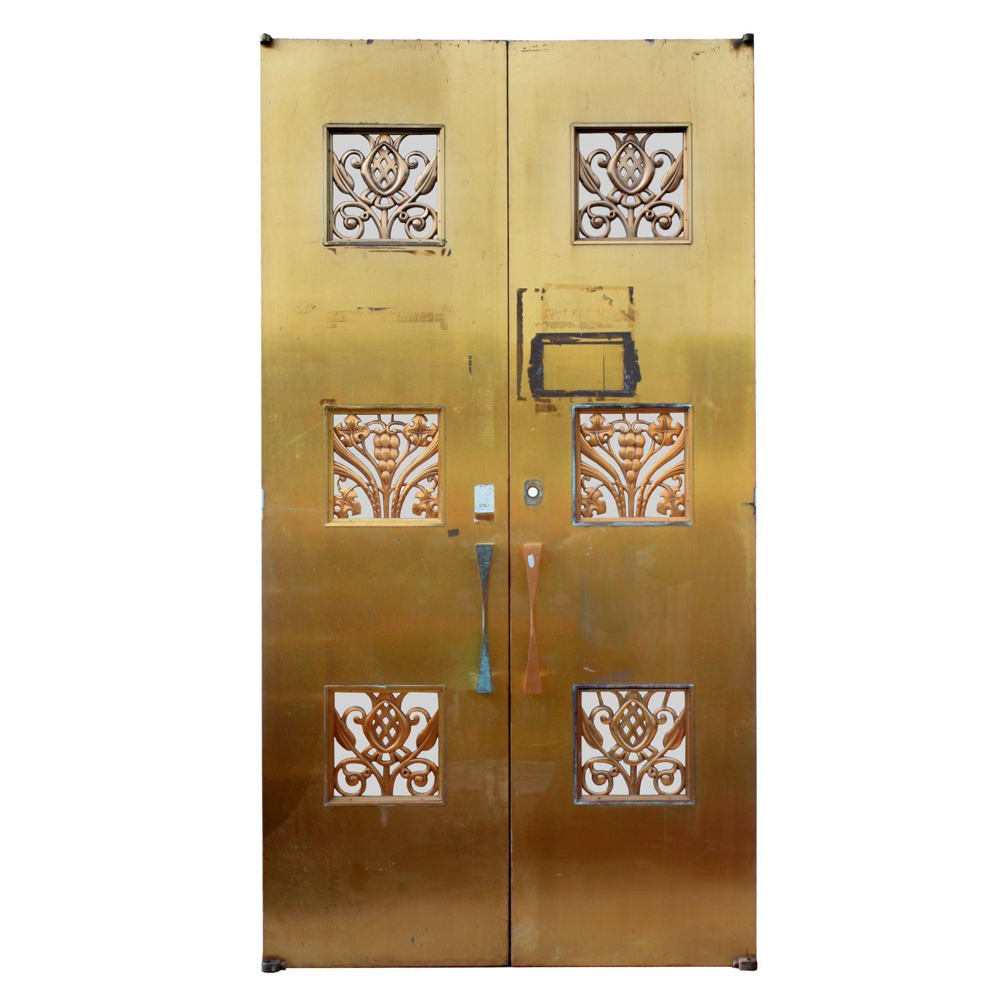 Reclaimed pair of antique art deco bronze doors early s