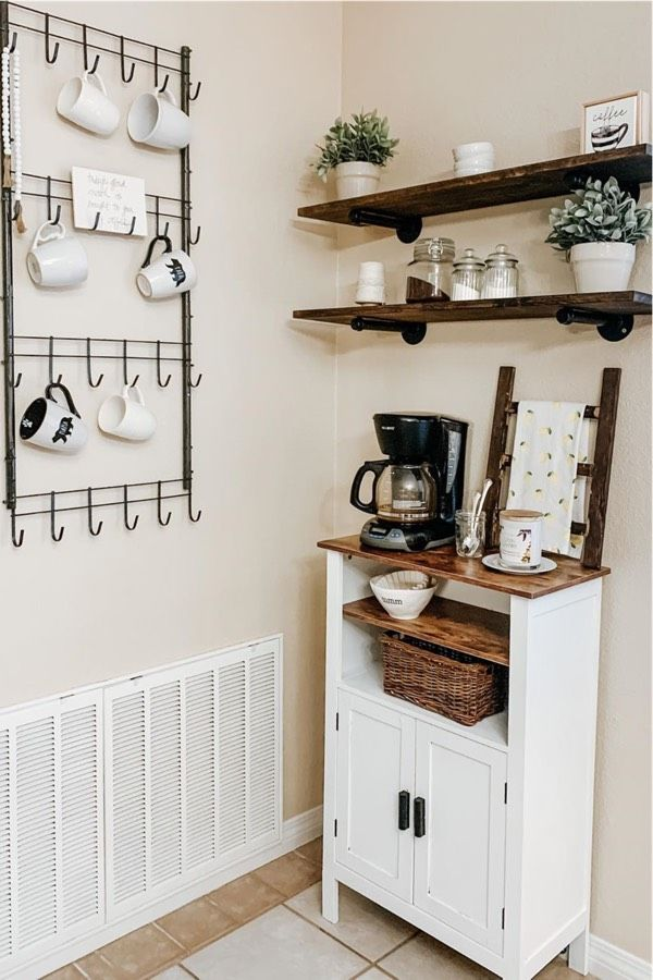 Whether you're looking for a creative way to display your coffee maker or want to hang up all your Rae Dunn cups, these coffee bar ideas will give you some inspiration! With everything from DIY designs to farmhouse decor, you'll find the perfect idea here! #coffeebar #coffeestation #coffeebarideas #raedunncoffee