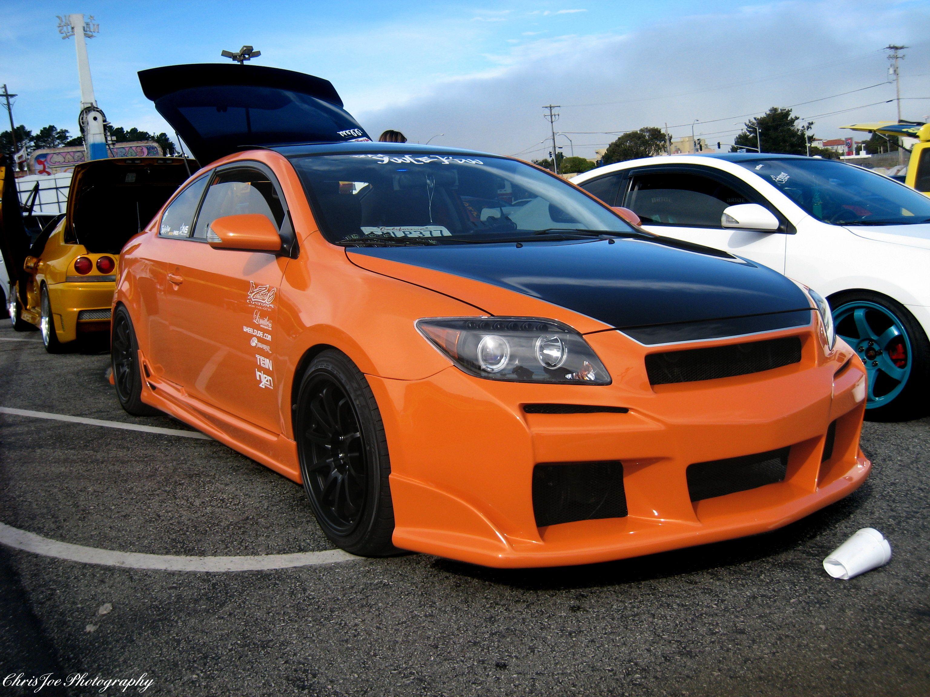 custom Scion tC in orange with black hood and wheels
