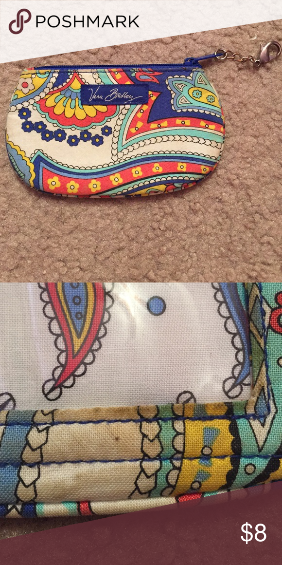 Vera Bradley coin bag Used Vera Bradley coin bag. No tears or rips. Just needs a little wash to get stain out from the back side (refer to second picture). Vera Bradley Bags Wallets