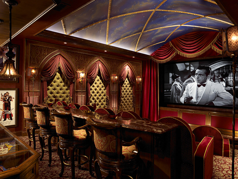 stunning home theater with painted ceiling