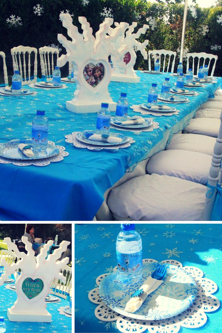 Frozen birthday table setup: blue napkin, white wooden trees with ...