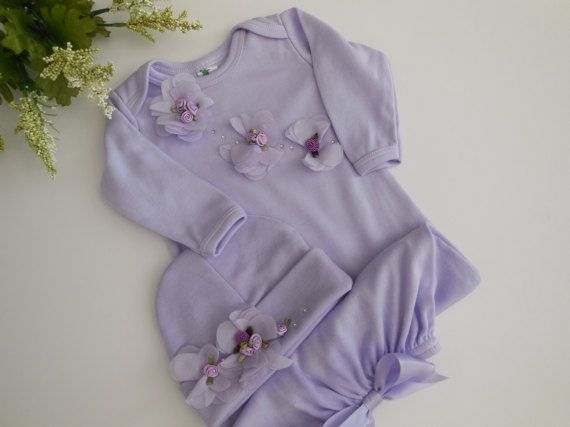 Perfect for bringing your little girl home for the first time, first picture or special occasion. This sweet Take me Home gown with a beautiful shade of lavender. It is embellished with a bouquet of purple chiffon, satin mini ribbon flowers and rhinestone .( Real Crystal Swarovsky )  The matching cap completes the outfit, each of these stunning gowns is lovingly hand made for your special little princess. Made from 100% cotton (7 oz interlock knit ) . The gown and cap are so soft and match…