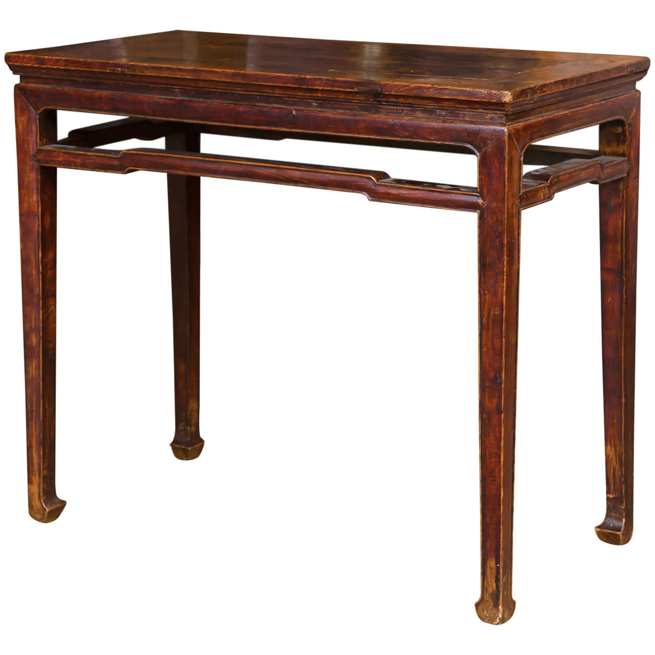 A 19th century Northern elmwood console table of simple strong lines.  The rectangular top over molded frieze and stretchers, square legs ending on horse hoof feet.