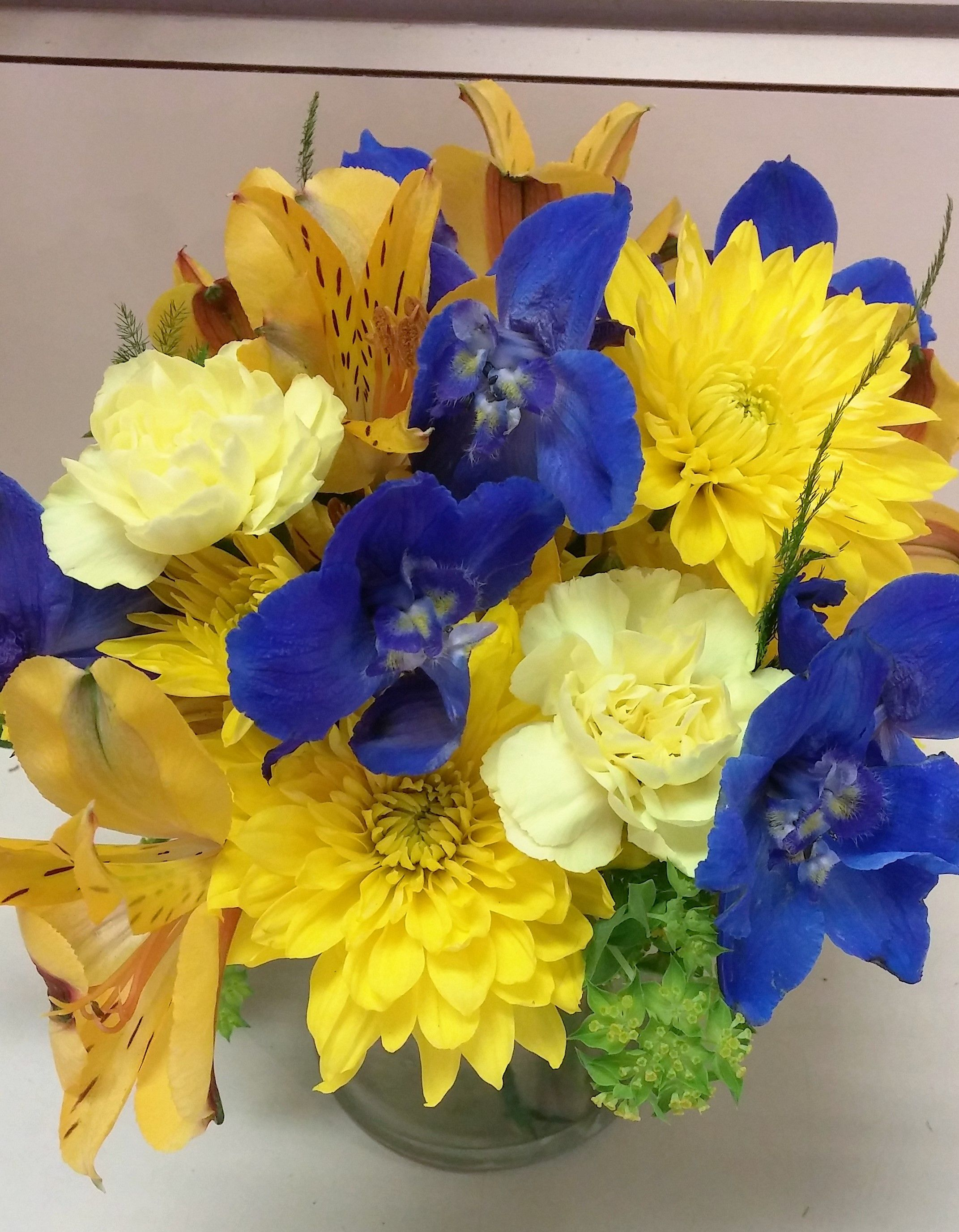 U of m flower arrangement maize and blue flowers blue delphinium u of m flower arrangement maize and blue flowers blue delphinium yellow alstroemeria yellow cushions yellow mini carnations perfect for a cocktail izmirmasajfo