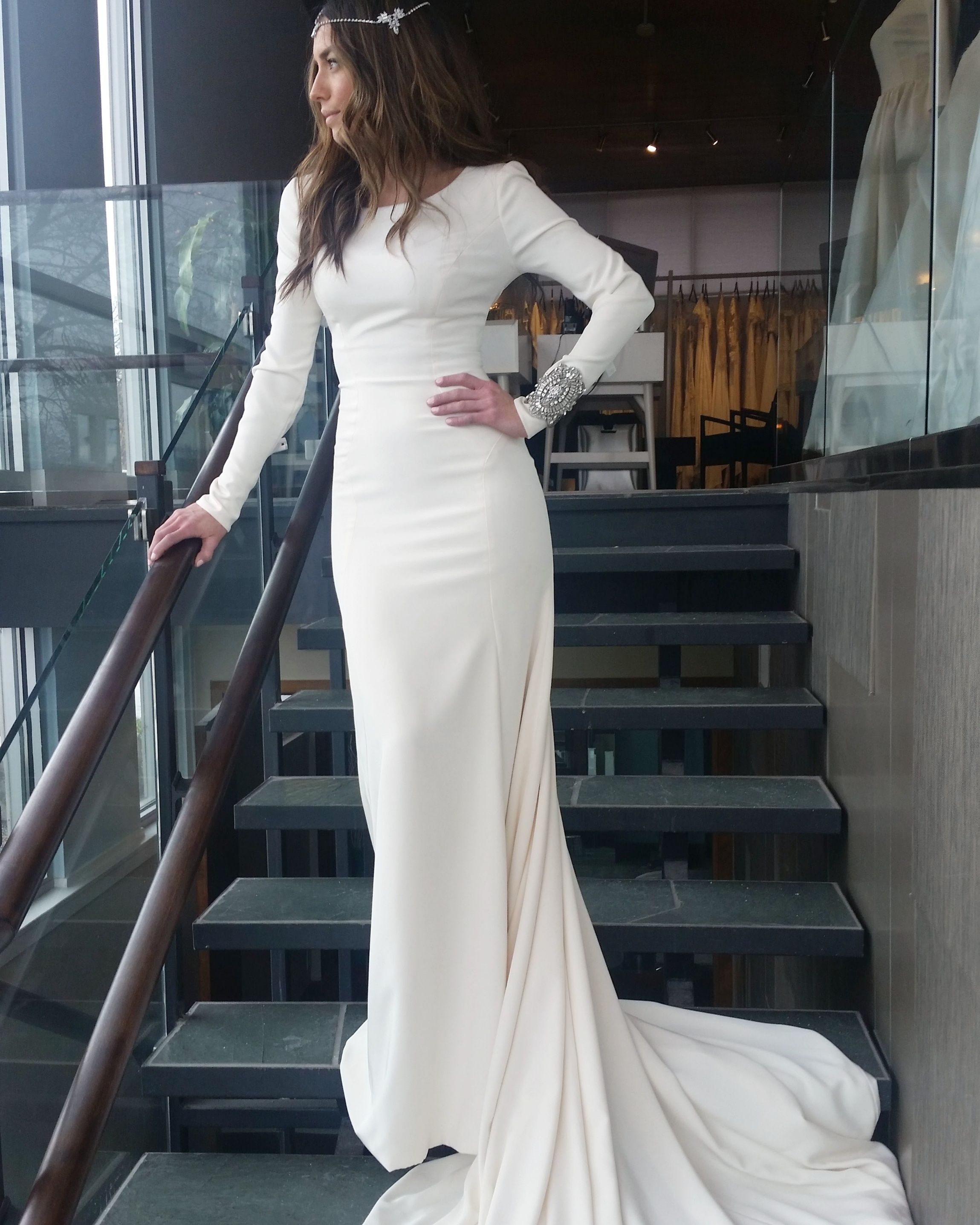 Modest wedding dress with long sleeves and a slim skirt from alta