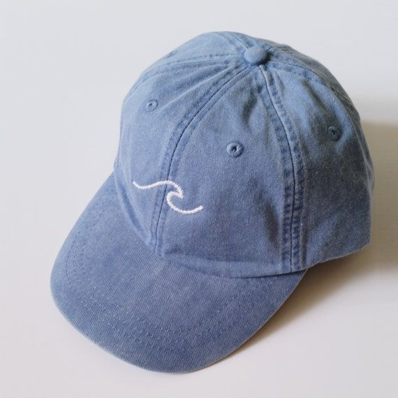 the perfect embroidered baseball cap with a simple wave design one size fits all cap has a leather adjustment strap in the back color may differ slightly