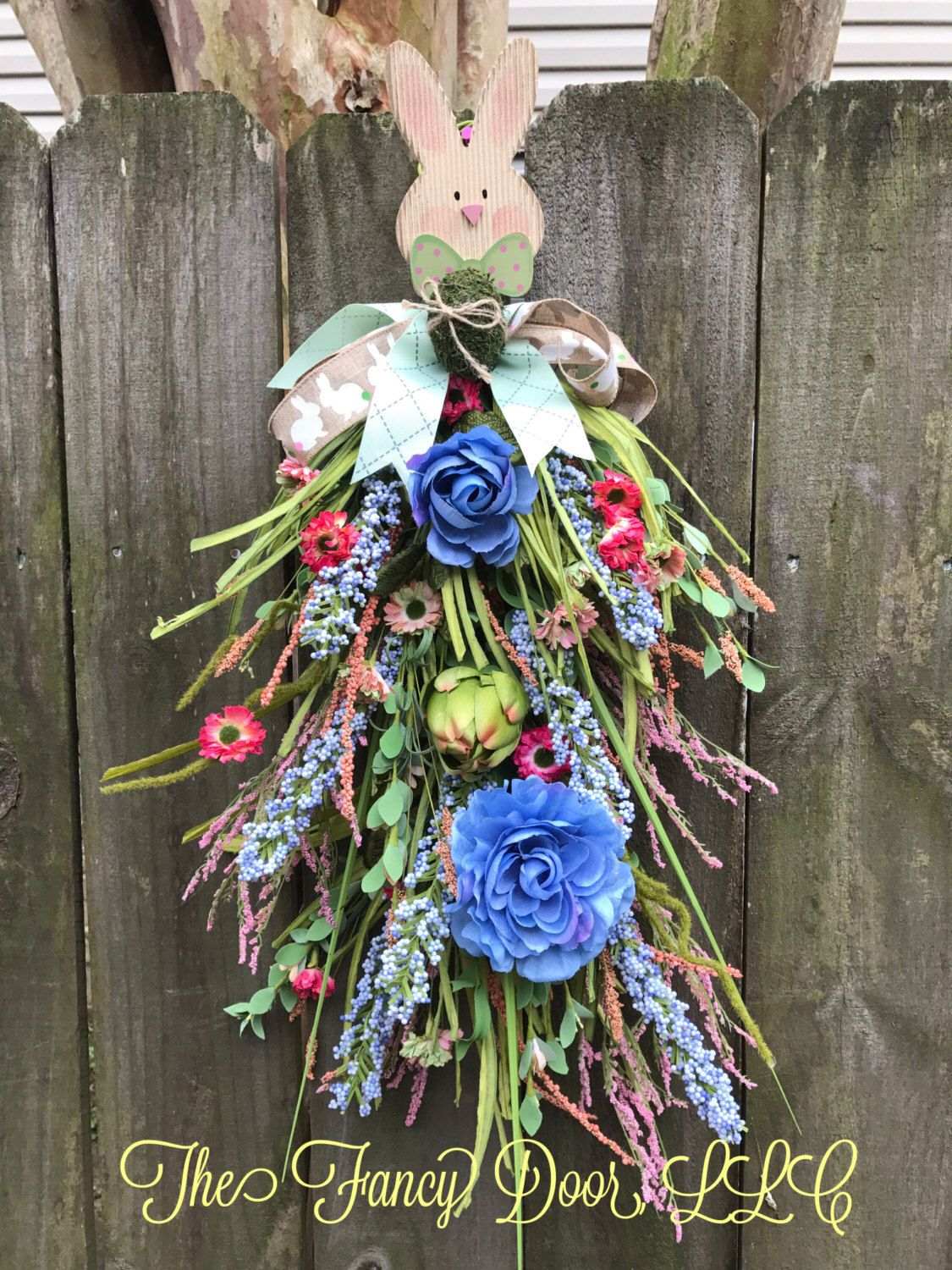A personal favorite from my Etsy shop https://www.etsy.com/listing/503589271/easter-swag-spring-swag-rabbit-door