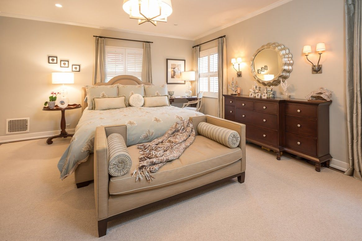 A custom bed and seating area create a luxurious Master Bedroom. by ...