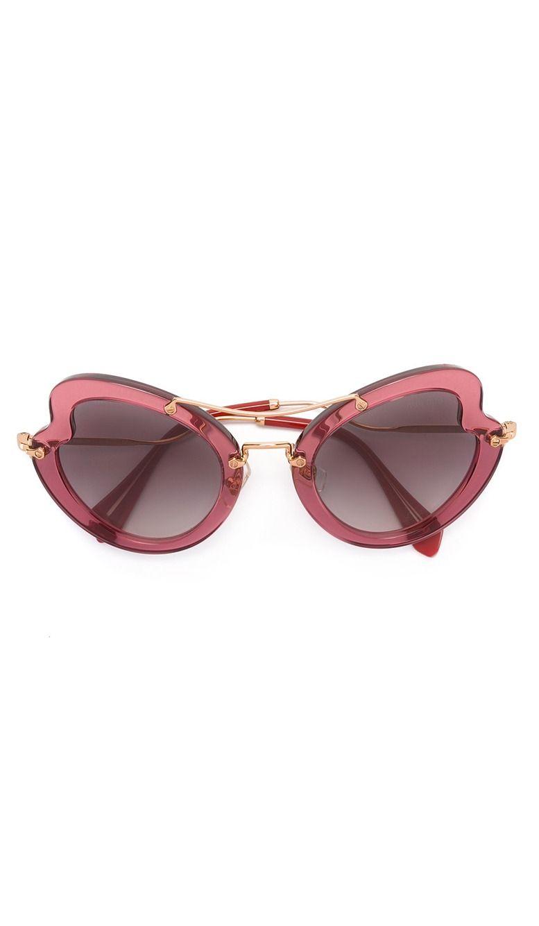 c7ec7aa9ff7a MIU MIU EYEWEAR wavy shaped sunglasses, explore Miu Miu at Farfetch now.
