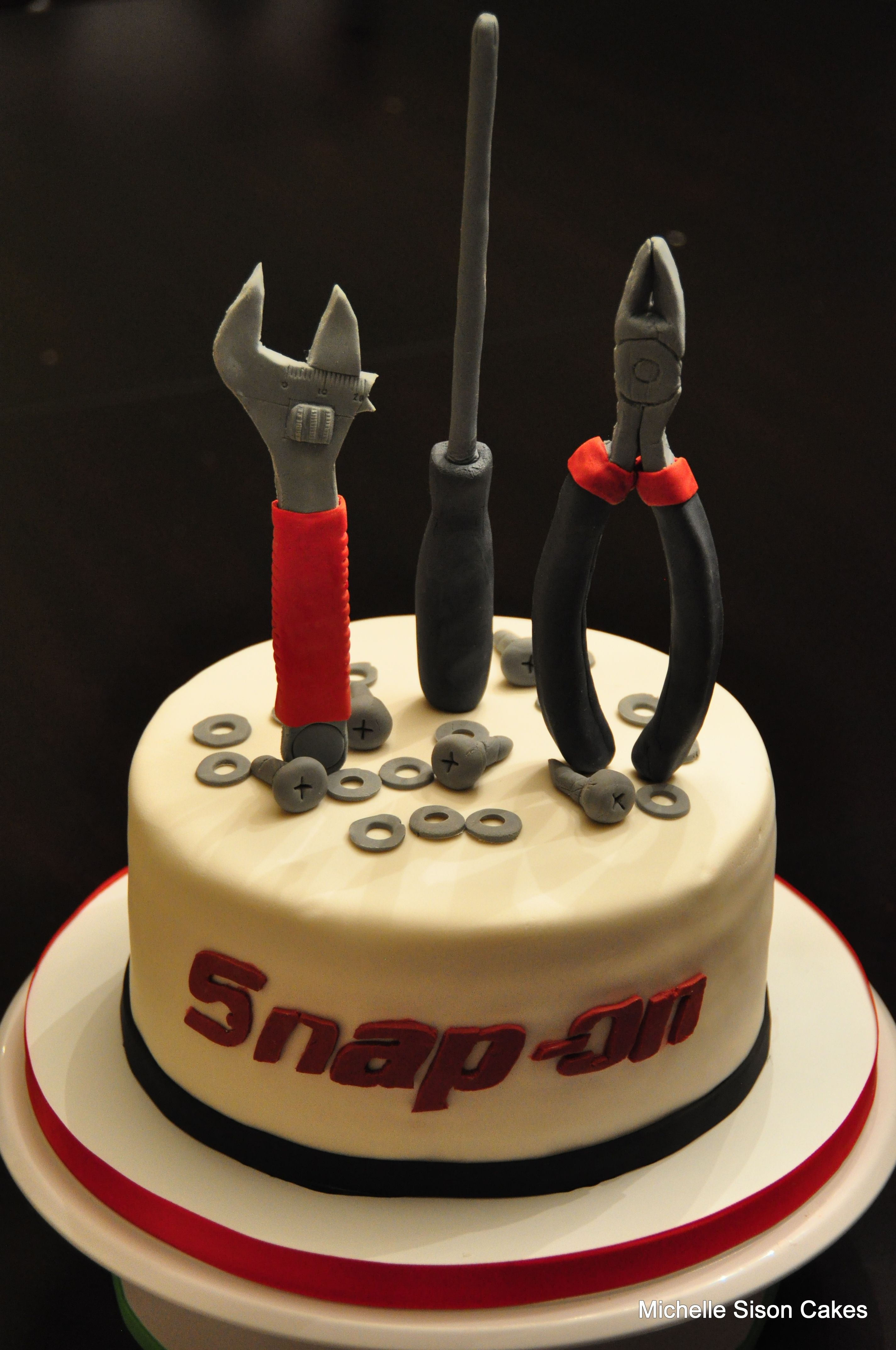 Snap on tool cake...I bet it's greasy. Nicole Apodaca...can you make ...