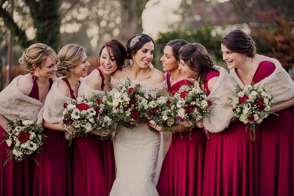 Love The Rich Red Bridesmaid Dresses And Fur Shawls For Winter Wedding In A Tipi With Lace Fishtail Gown Jenny Packham Headpiece Rachel Simpson