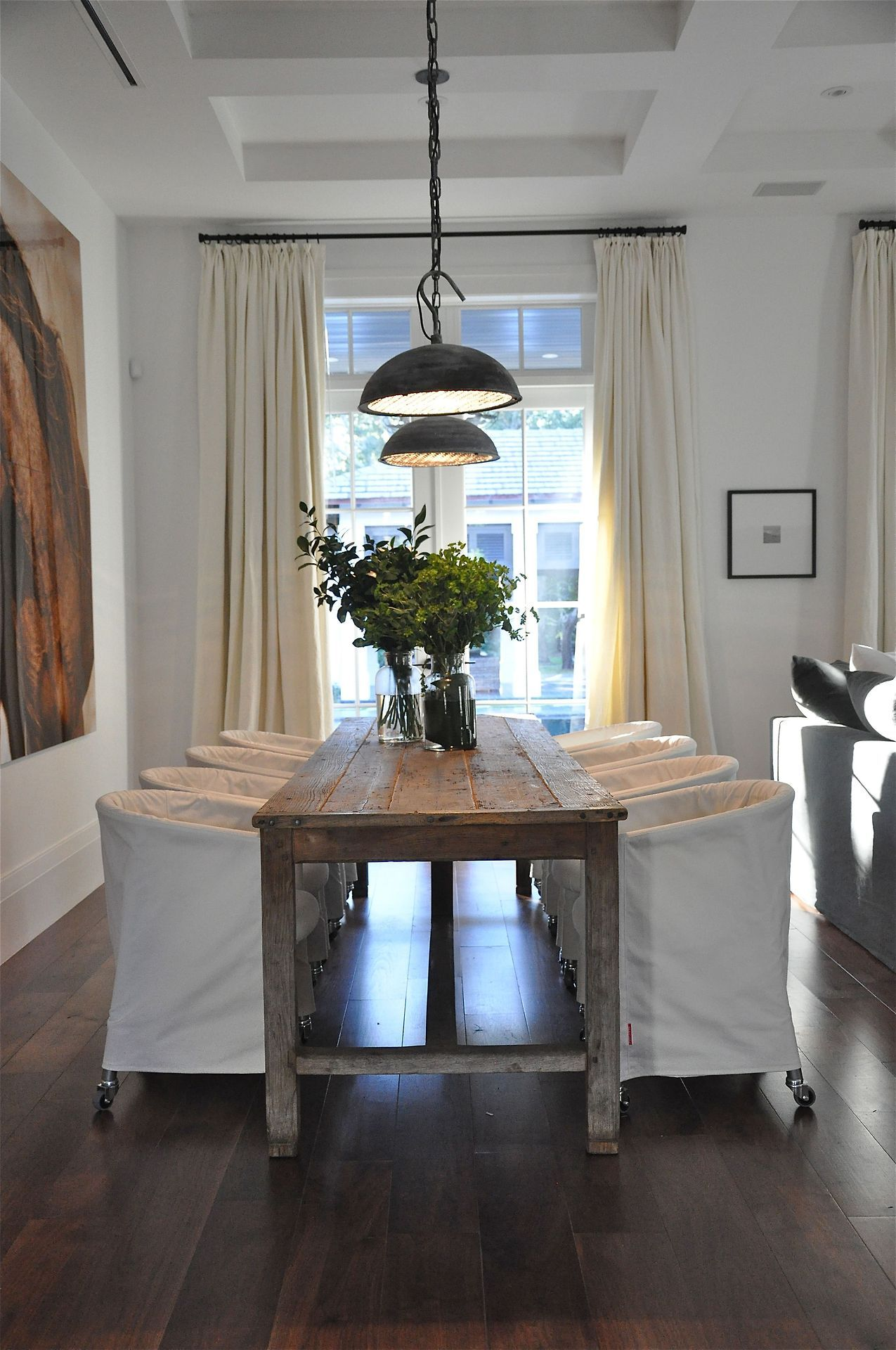 .Rustic table, slip-covered chairs.