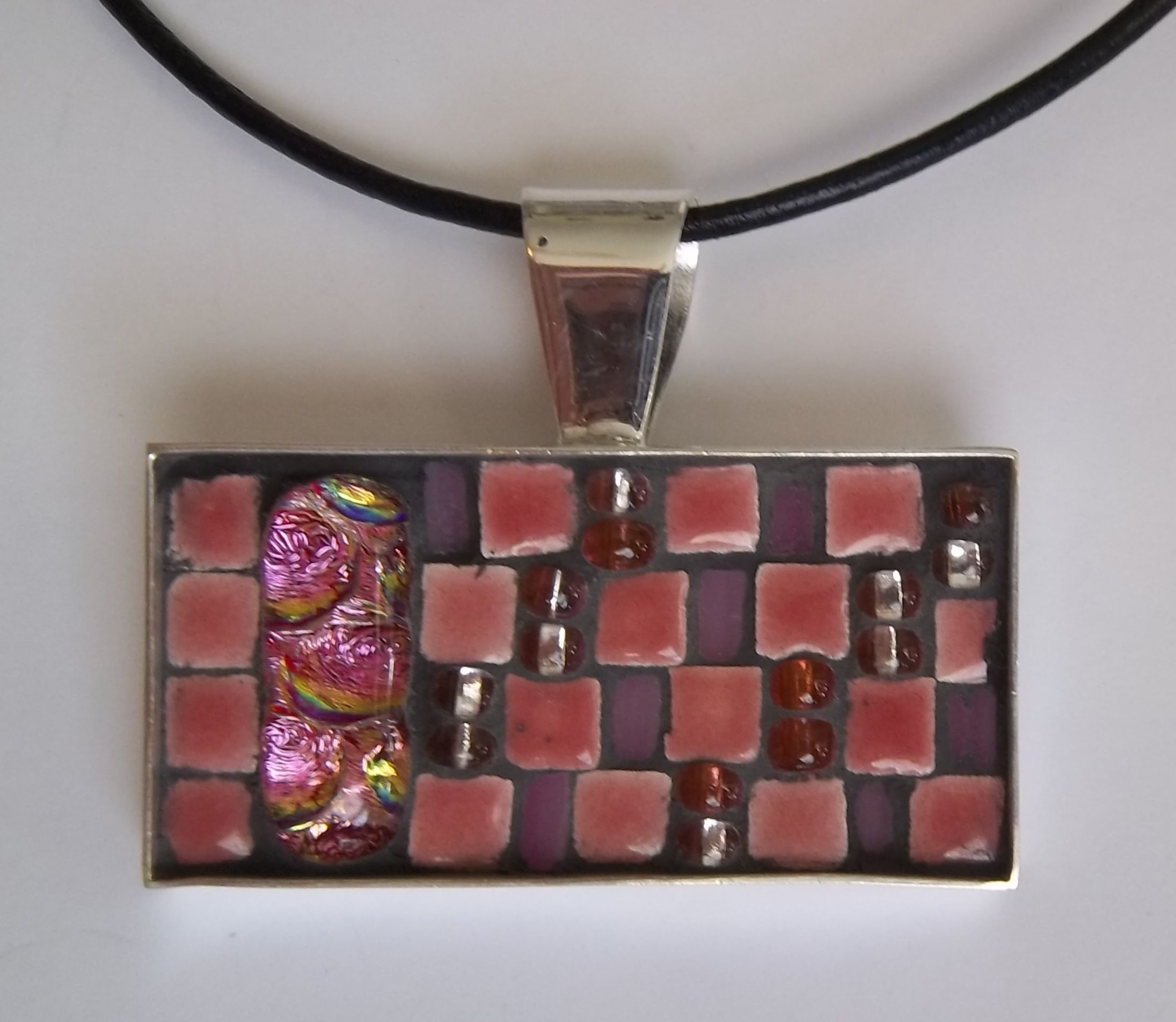 Mosaic Pendant  Made with glass beads, ceramic tiles and dichroic glass in a silver overlay bezel.  www.sallymays.co.nr