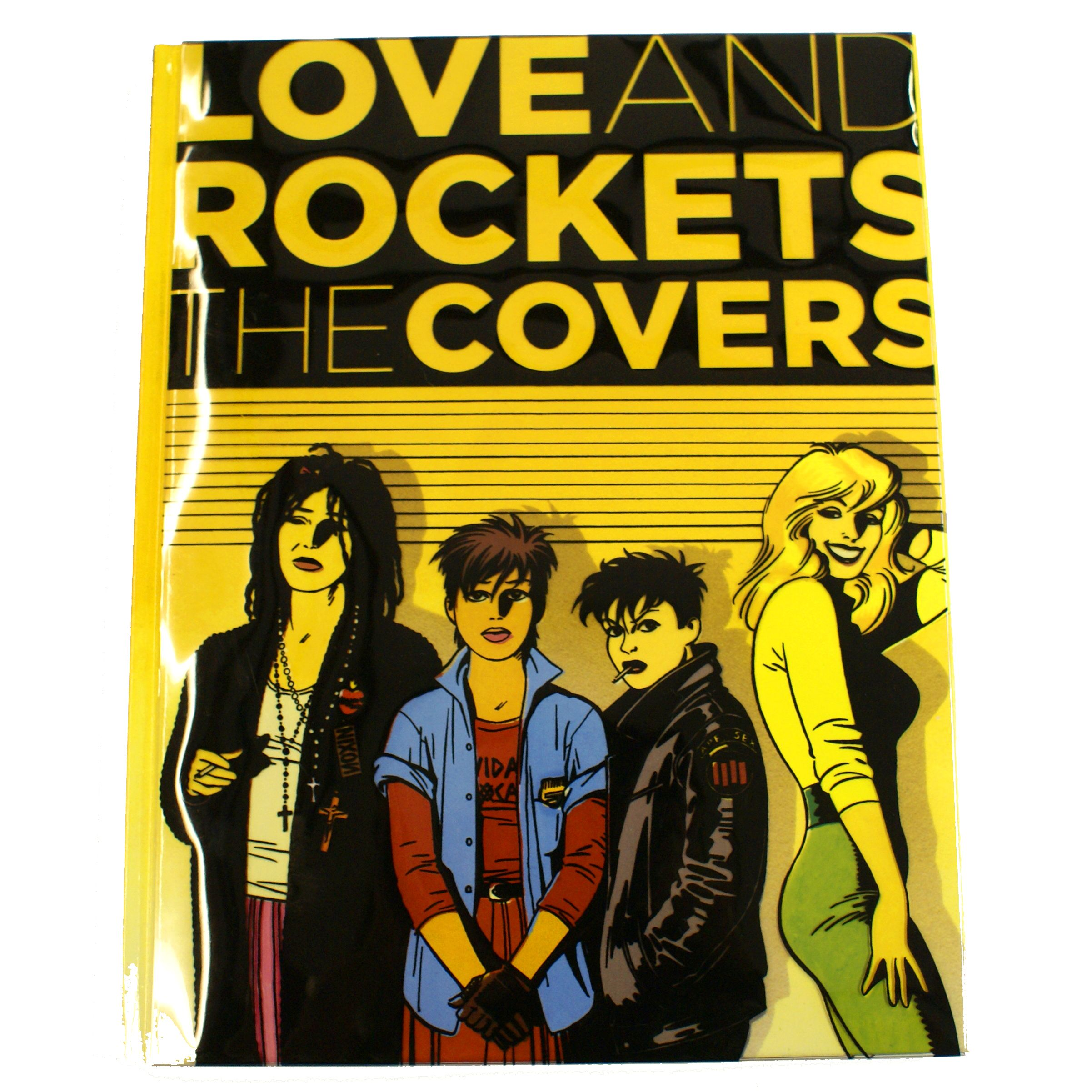 Love and Rockets The Covers produced for Fantagraphics includes all the original covers from the comic book series.  A transparent PVC sleeve is wrapped around the front cover and provides the black element of the illustration behind it.