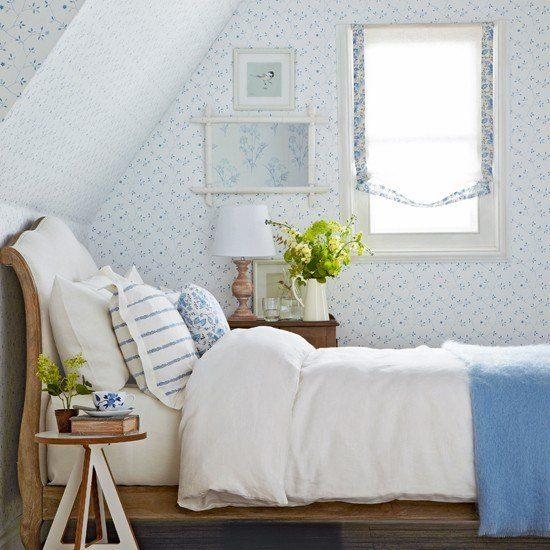 blue and white cottage bedroom with sleigh bed