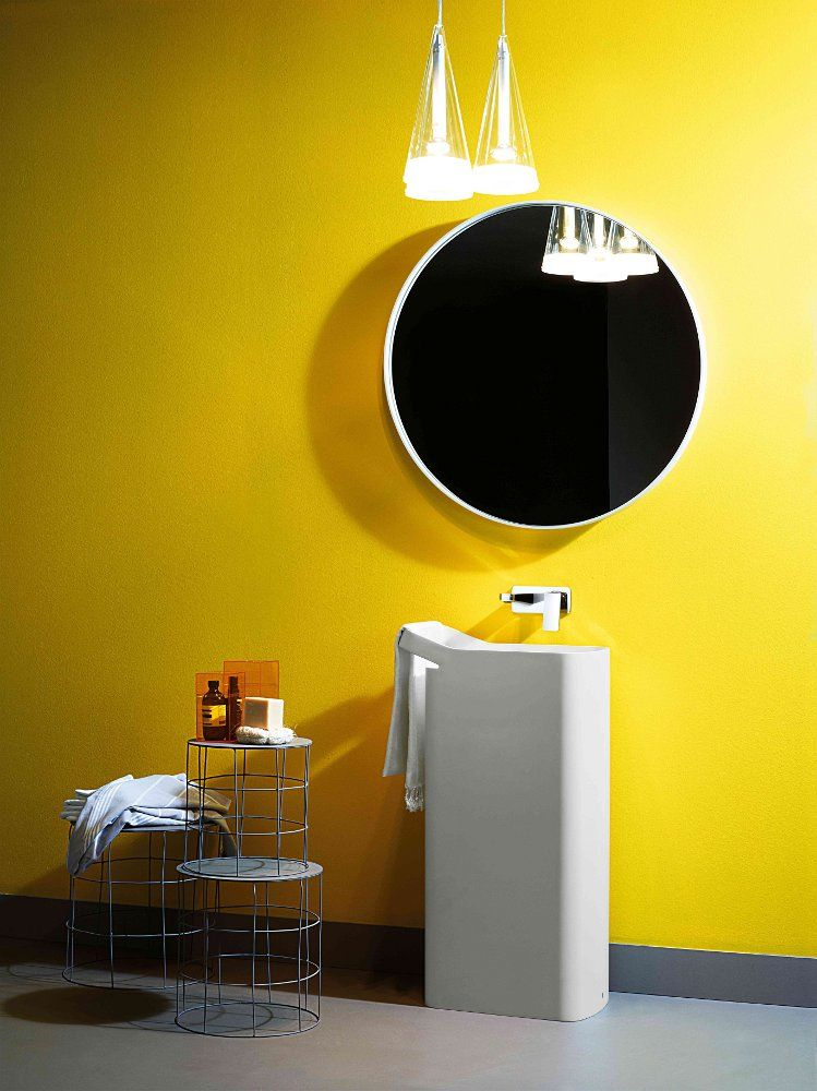 "Great use of bold colour in the bathroom. ""KOS washbasins designed by Ludovica+Roberto Palomba #yellow #bathroom"""
