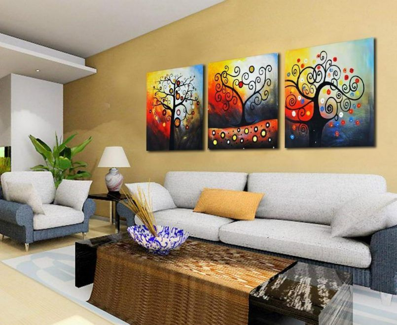 Living Room Best Decoration Idea With Frame On The Wall Including Long Table Rug As Well Brown Painting Also Elegant Sofa And Plant