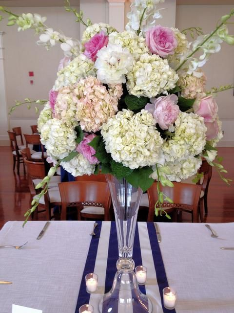 Tall centerpiece featuring hydrangeas peonies garden