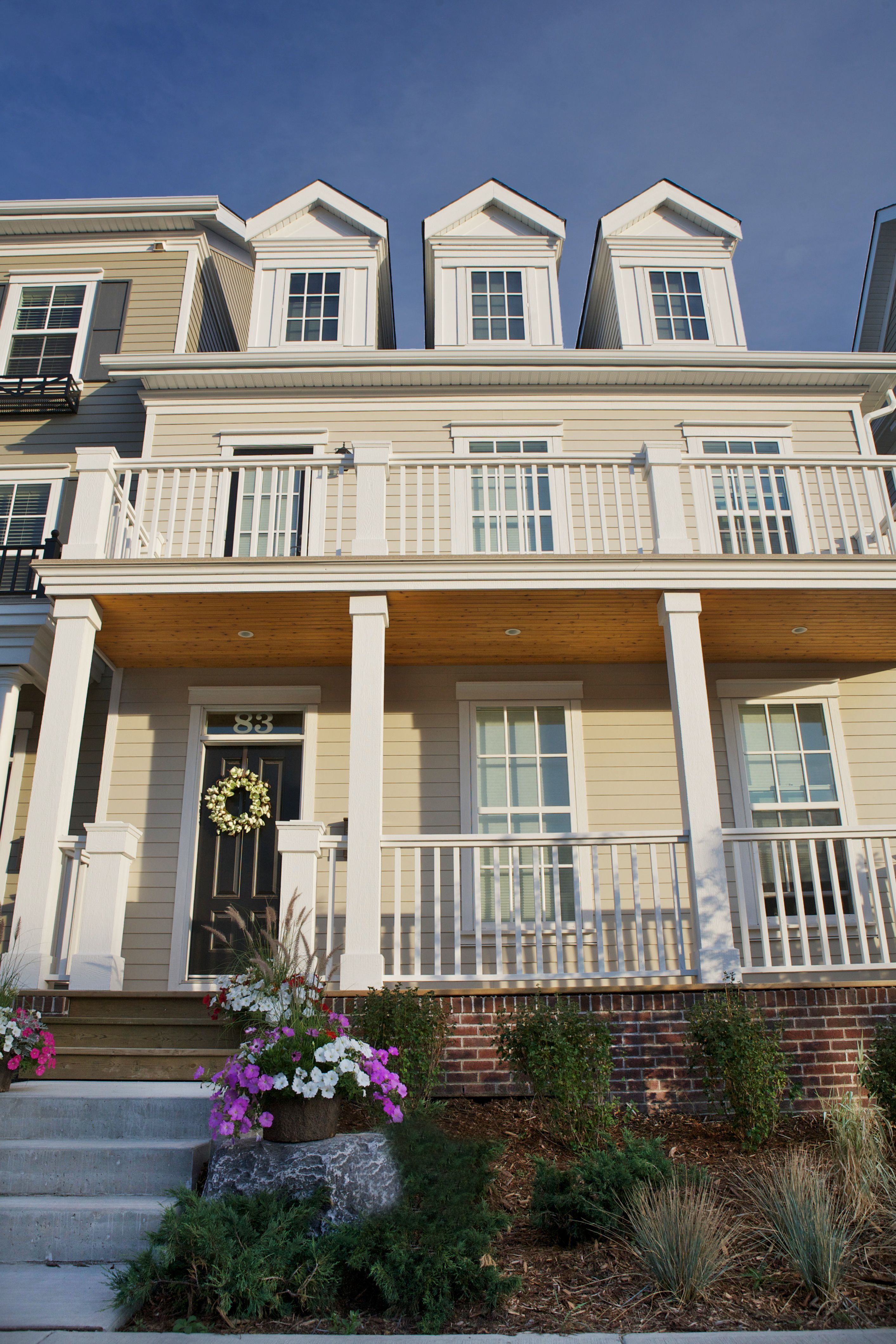 Colonial Homes With Dormer Windows Custom Window Boxes James Hardie Siding And Brick Victoria Cross Townhomes In Colonial House House Styles Hardie Siding