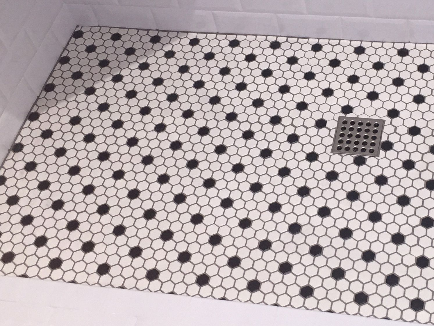 Shower floor from fully remodeled bathroom, done in black and white ...