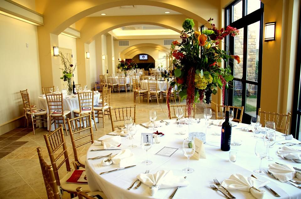 Gold Chivari Chairs With Bright Floral Arrangements Create An
