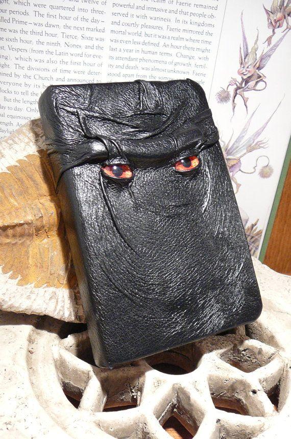 Mythical Beast Book (Black leather with Orange eyes). $35.95, via Etsy.