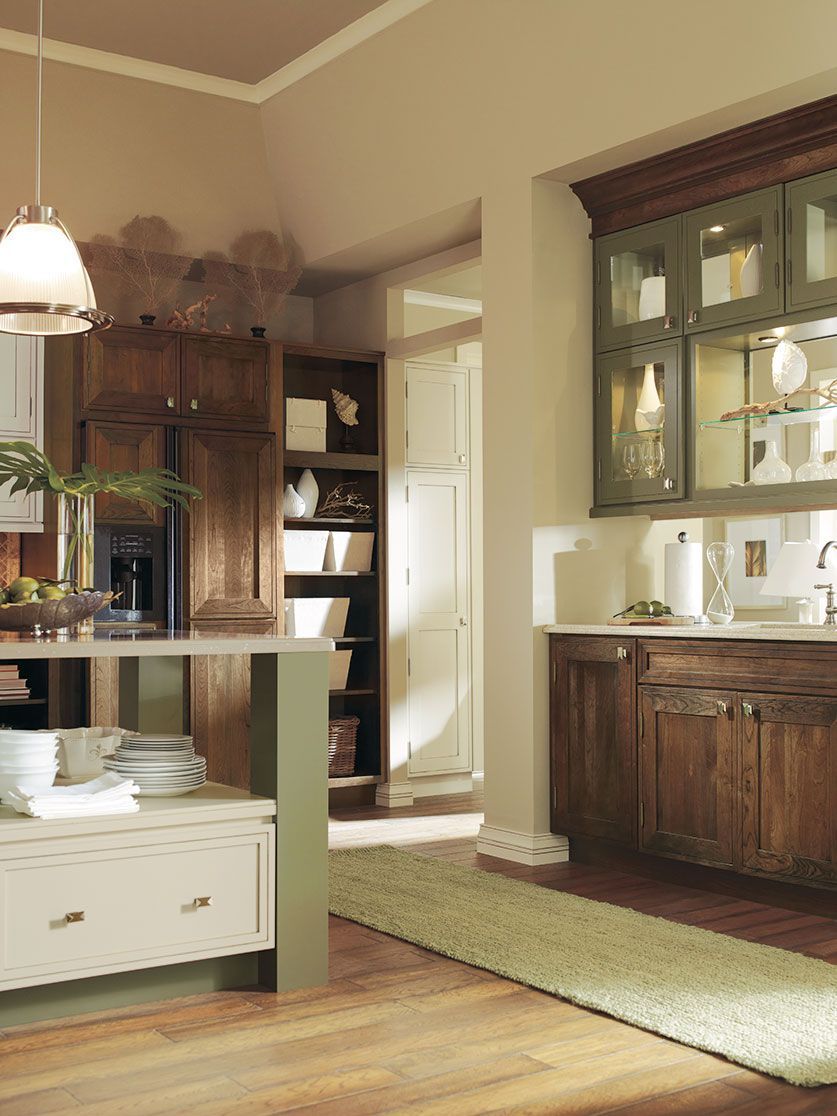 We can't help but love the unique way this kitchen ...