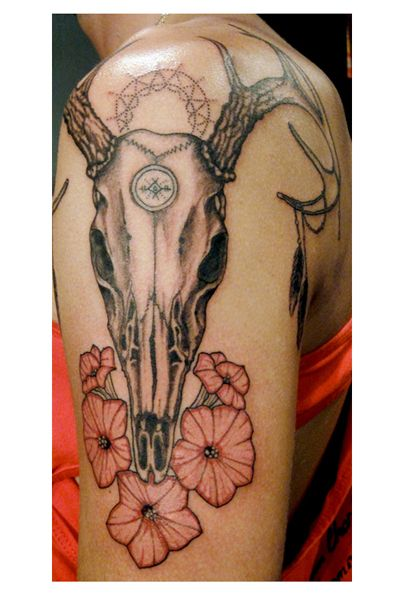 Tattoo by Minka Sicklinger. Cow skull with flowers