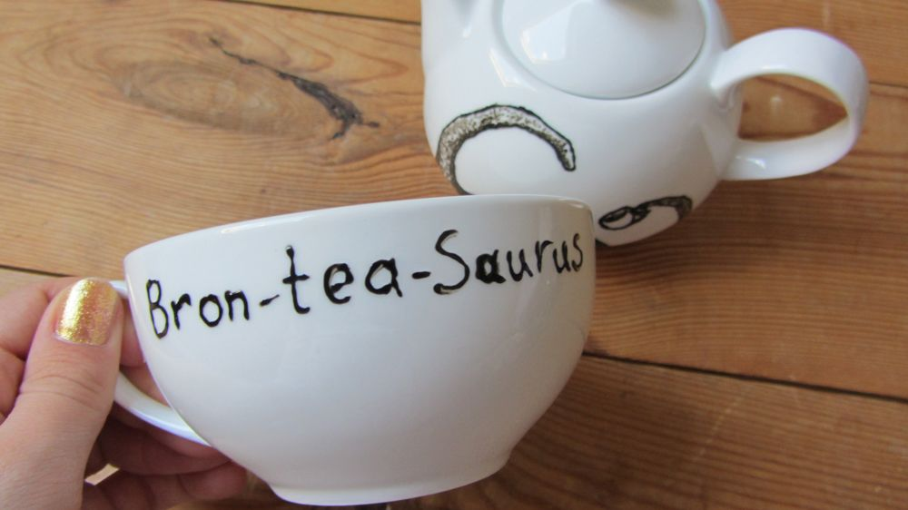 Back of the tea cup of the Bron-tea-saurus Tea for One    https://www.etsy.com/shop/gallonsofink