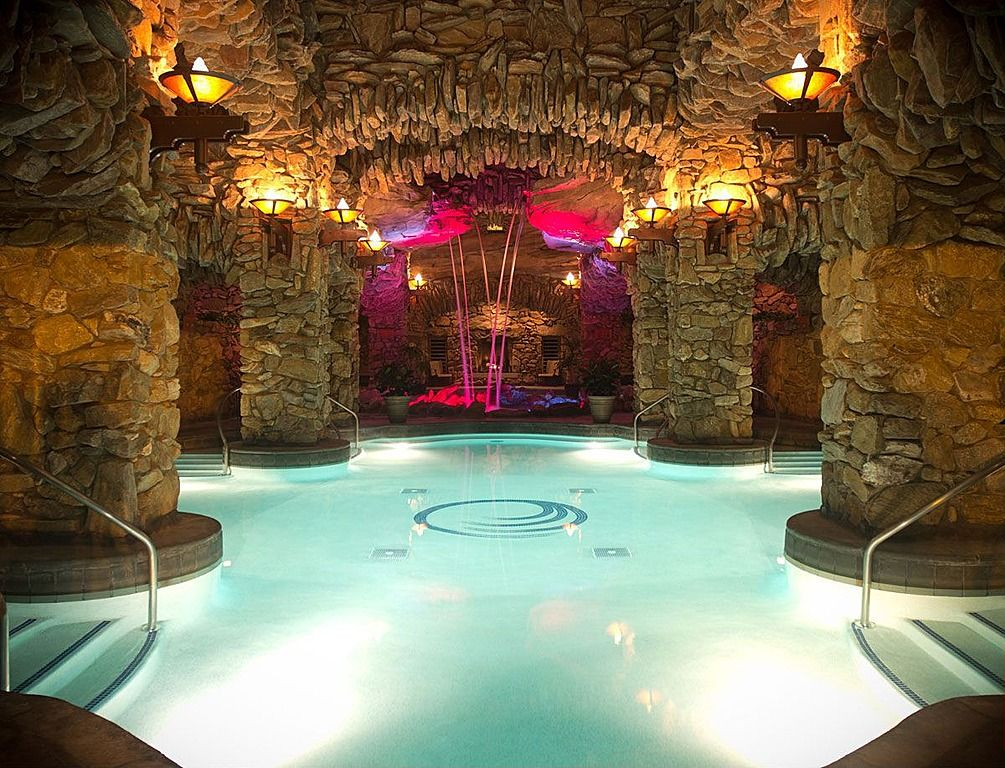 this swanky pool grotto features an electric lounge area for swimmers looking for a