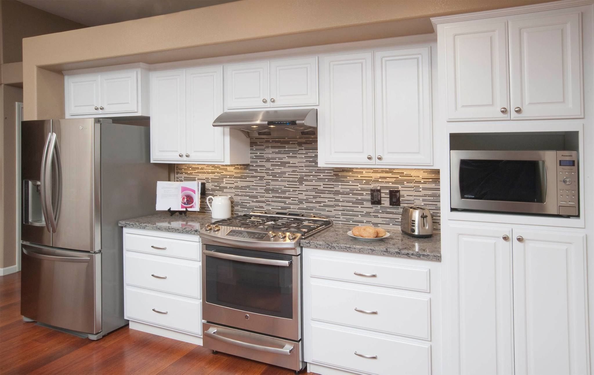 Check Out This Amazing Refacing Job By Kitchen Mart Featuring Our FS742  Door In 949 White