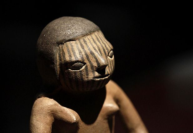 """""""Gold, Prehispanic art from Colombia"""" exhibition A ceramic figurine of a seated woman with a painted face is seen at the exhibition """"Gold, Prehispanic art from Colombia"""" at the National Museum of Cultures in Mexico City."""