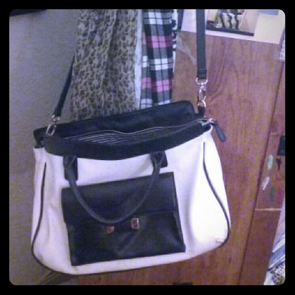 Large over the shoulder bag Excellent condition large size purse comes with long strap or you can take it off and becomes a hand purse. Expressions NYC Bags