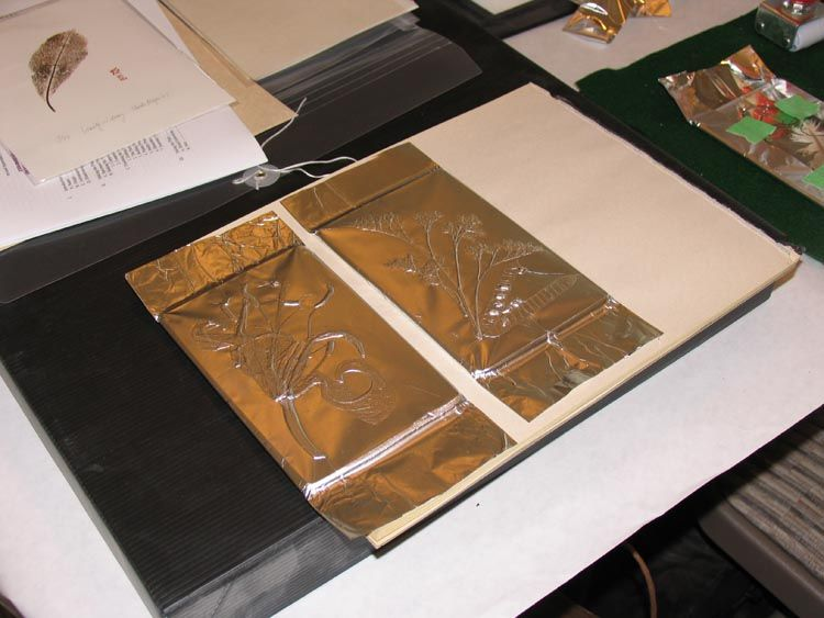 Using aluminium foil over natural materials to form the printing plate.