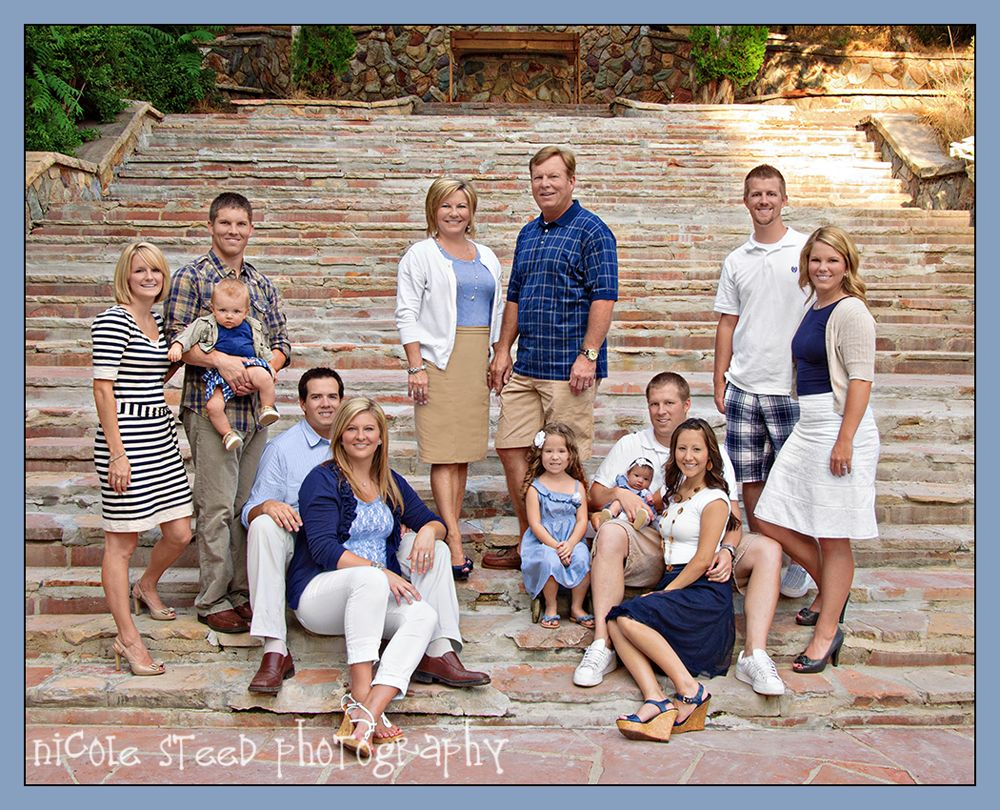 Cute extended family pose what to wear for family photos blue white and tan mix and match patterns