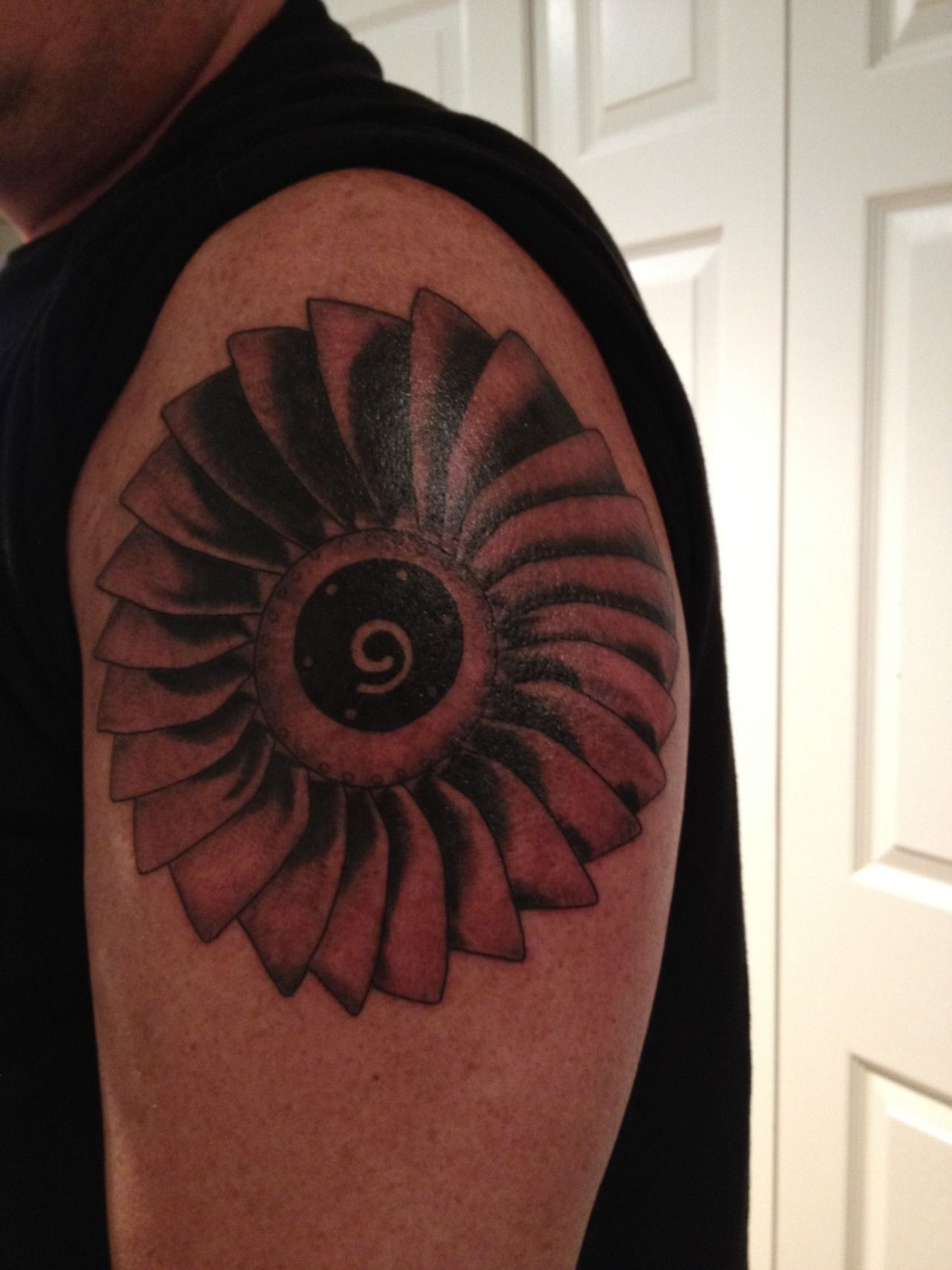 hmmm maybe but girly this is a tattoo of the fan blades of a 737 jet engine im an aircraft mechanic done by mike carter of ink inc in mckinney tx turbine engine mechanic