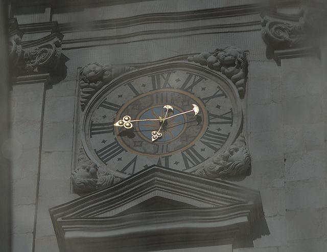 """""""Time Warp"""" ~ clock reflection in a puddle, Salzburg Cathedral"""