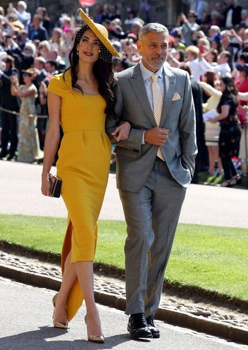 George and Amal Clooney walking together at the royal wedding ... a18895096ee