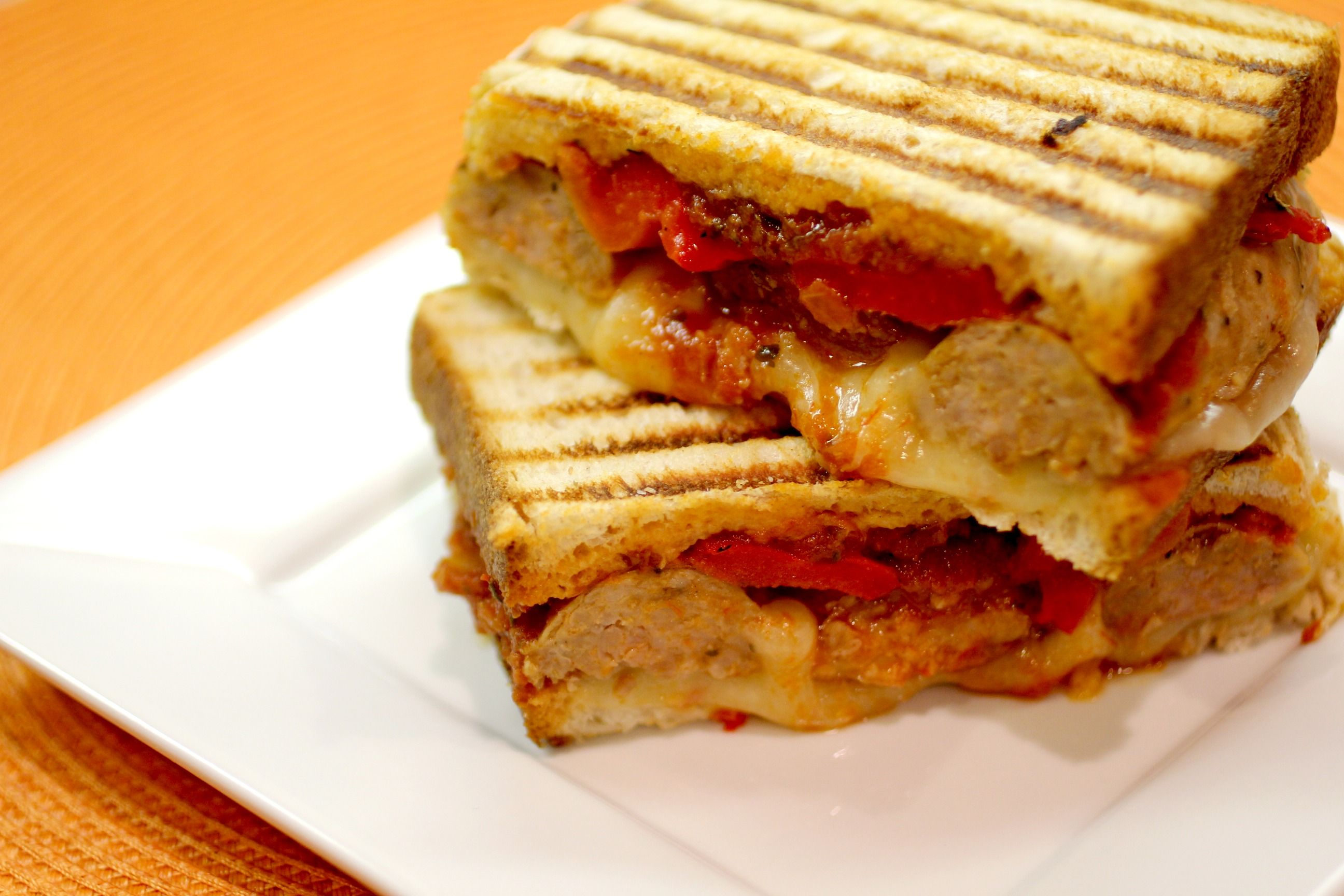 Italian Sausage Panini - This is a super filling and man-pleasing sandwich!  Sausage, provolone, roasted peppers, marinara...mmmmmm.