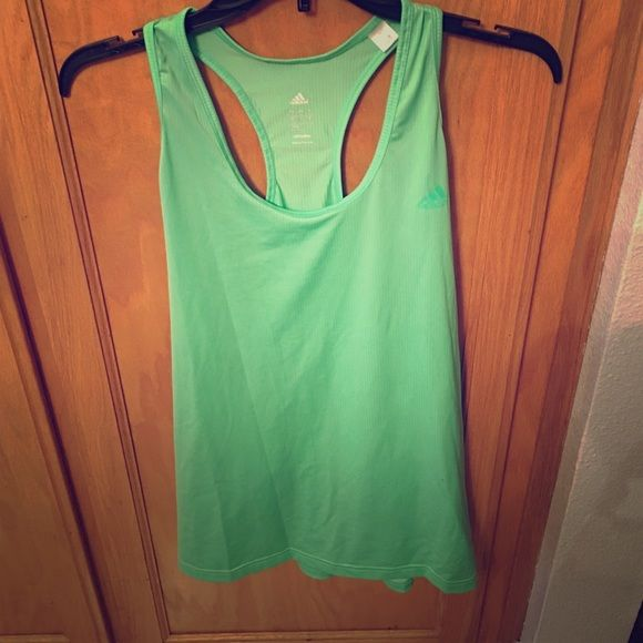 Adidas workout tank! Neon green! This tank is dri-fit adidas in an xl! The color is more of a highlighter bright neon green rather than the turquoise color that the pictures seem to look. Adidas Tops Tank Tops