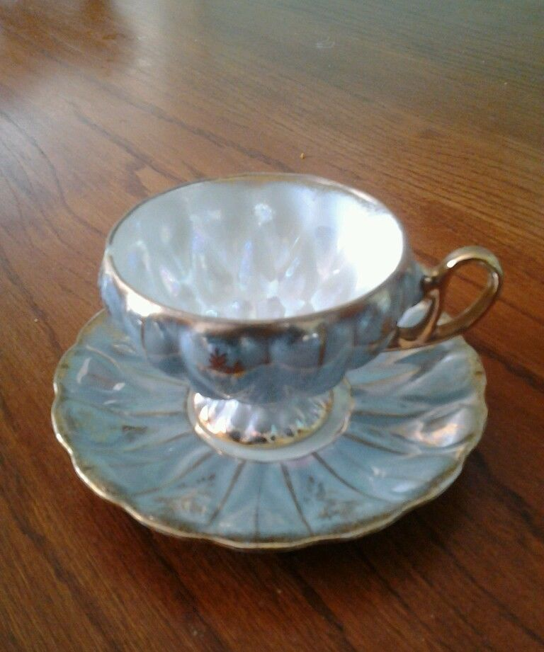 Tea cup and saucer has one small chip on side of cup