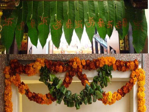 Here Is A Toran Made From Actual Mango Leaves And Marigolds For Good Fortune Wedding Backdrop Decorations Diwali Decorations Diwali Decoration Items